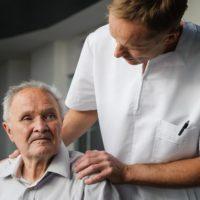 Healthcare worker interested in health elderly man